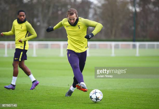 Harry Kane passes the ball during a Tottenham Hotspur training session on the eve of their UEFA Champions League match against Juventus at Tottenham...