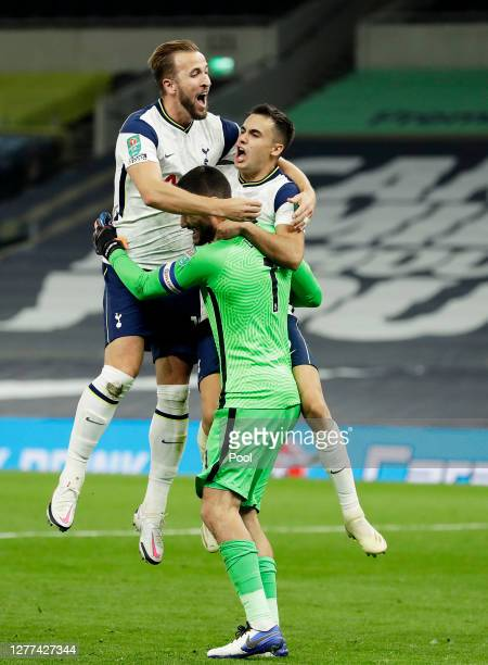 Harry Kane, Sergio Reguilon and Hugo Lloris of Tottenham Hotspur celebrate following their team's victory in the Carabao Cup fourth round match...