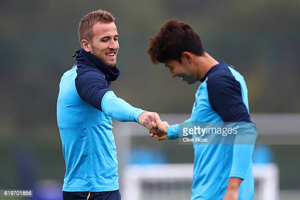 Harry Kane speaks with HeungMin Son during a Tottenham Hotspur training session ahead of their UEFA Champions League Group E match against Bayer 04...