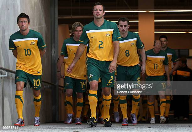 Harry Kewell and Lucas Neill of Australia walk out for an Australian Socceroos training session at AAMI Park on May 19 2010 in Melbourne Australia
