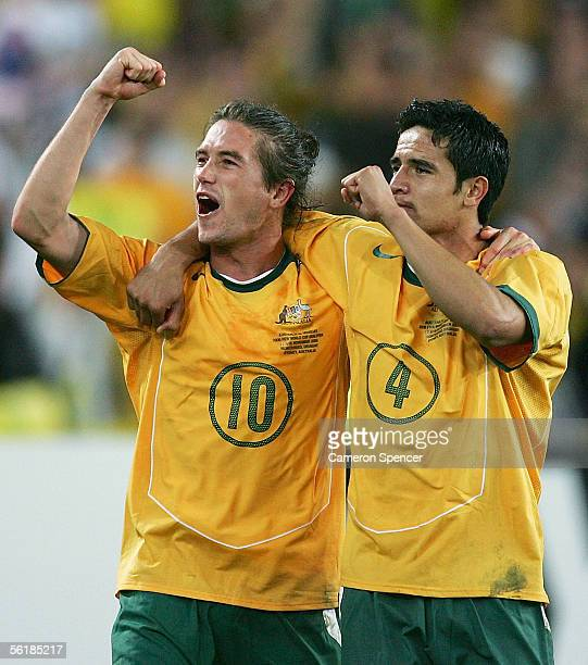 Harry Kewell and Tim Cahill of the Socceroos celebrate victory after the second leg of the 2006 FIFA World Cup qualifying match between Australia and...