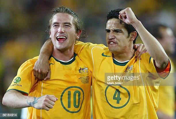 Harry Kewell and Tim Cahill of the Socceroos celebrate winning the second leg of the 2006 FIFA World Cup qualifying match between Australia and...