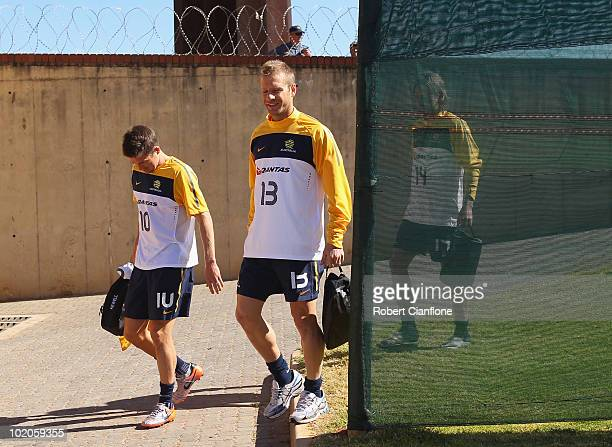 Harry Kewell and Vince Grella of Australia arrive an Australian Socceroos trainin session at Ruimsig Stadium on June 14 2010 in Roodepoort South...