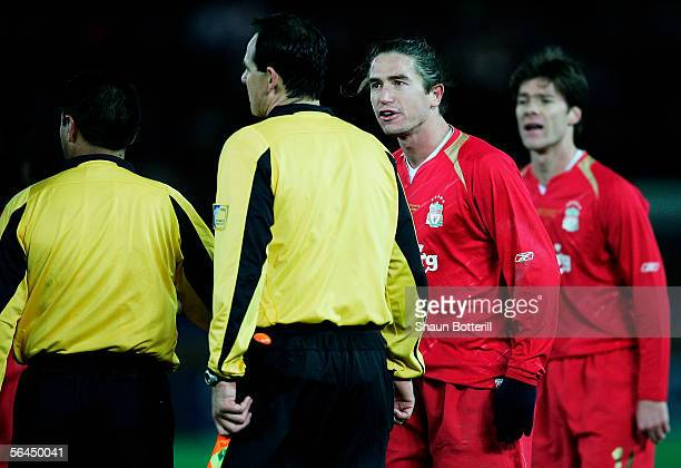 Harry Kewell and Xabi Alonso of Liverpool argue with assistant referee Hector Vergara at the final whistle during the FIFA Club World Championship...