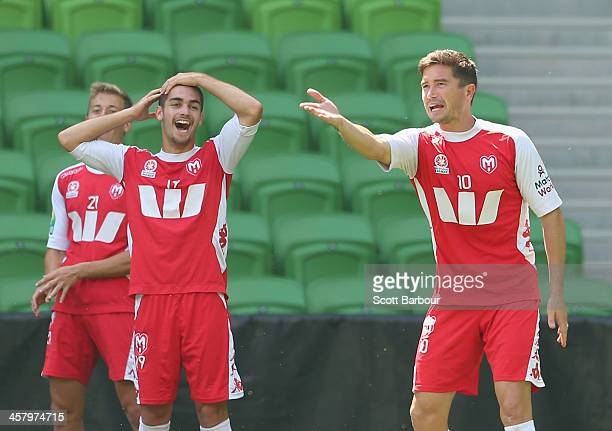 Harry Kewell gestures as Ben Garuccio looks on during a Melbourne Heart ALeague training session at AAMI Park on December 20 2013 in Melbourne...