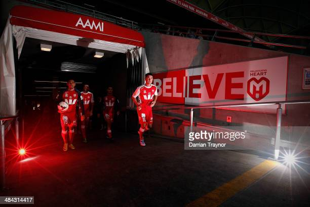 Harry Kewell leads his team out for the warm up in his last professinal football match during the round 27 ALeague match between Melbourne Heart and...