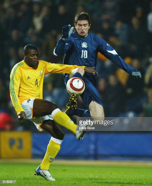 Harry Kewell of Australia battles with Aaron Mokoena of South Africa during the International Friendly match between Australia and South Africa at...