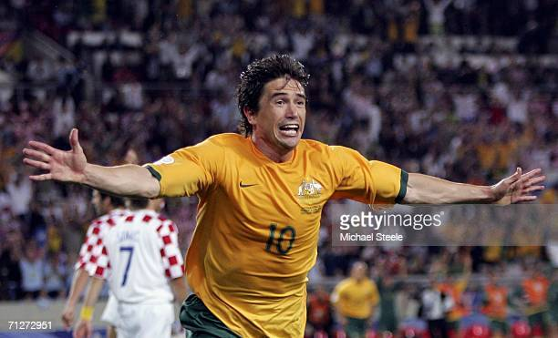 Harry Kewell of Australia celebrates after scoring his team's second goal to level the scores at 22 during the FIFA World Cup Germany 2006 Group F...