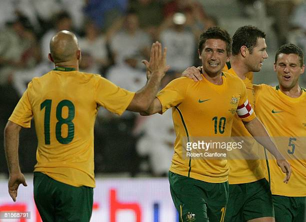 Harry Kewell of Australia celebrates his goal with teammate Mark Bresciano during the 2010 FIFA World Cup qualifying match between Qatar and...