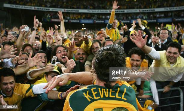 Harry Kewell of Australia celebrates victory with fans after the second leg of the 2006 FIFA World Cup qualifying match between Australia and Uruguay...