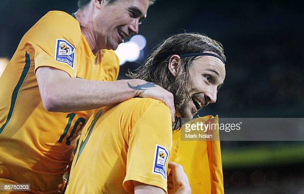 Harry Kewell of Australia celebrates with Joshua Kennedy after Kennedy scored a goal during the 2010 FIFA World Cup qualifying match between the...