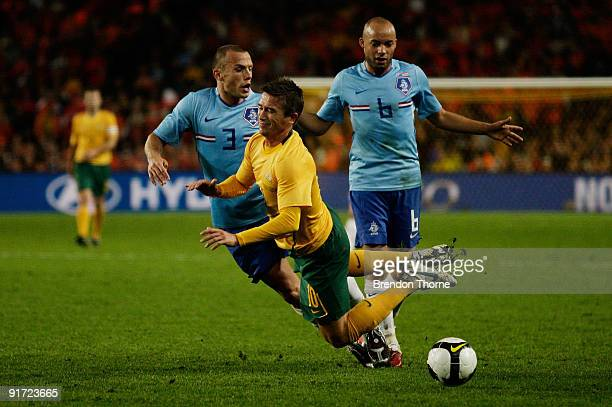 Harry Kewell of Australia competes with the Netherlands defence during the international friendly match between Australia and the Netherlands at...