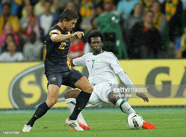 Harry Kewell of Australia contests with Kamil Saddiq of Saudi Arabia during the Group D 2014 FIFA World Cup Asian Qualifier match between Australia...