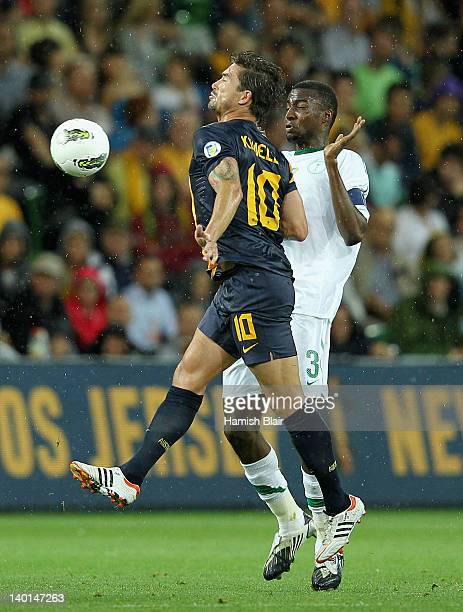 Harry Kewell of Australia contests with Osama Hawsawi of Saudi Arabia during the Group D 2014 FIFA World Cup Asian Qualifier match between Australia...
