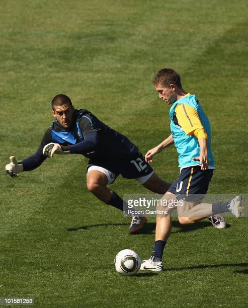 Harry Kewell of Australia gets the ball past goalkeeper Adam Federici during an Australian Socceroos training session at St Stithians College on June...