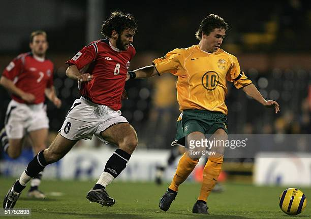 Harry Kewell of Australia holds off Magne Hoset of Norway during the International friendly match between Australia and Norway at Craven Cottage on...