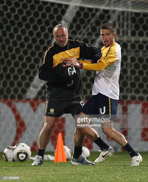 Harry Kewell of Australia is pressured by assistant coach Graham Arnold during an Australian Socceroos training session at St Stithians College on...