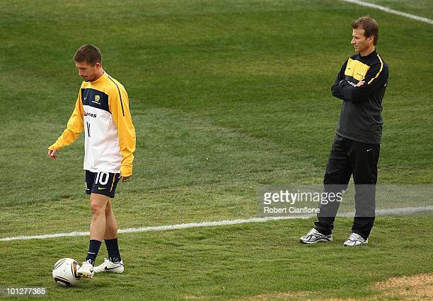 Harry Kewell of Australia is watched by physio Les Gelis as he trains away from the main group during an Australian Socceroos training session at St...