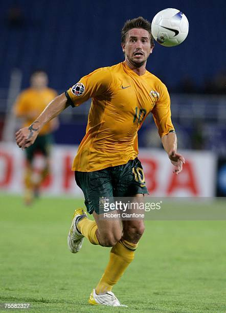 Harry Kewell of Australia looks to get the ball forward during the AFC Asian Cup 2007 Quarter Final between Japan and the Australian Socceroos at My...