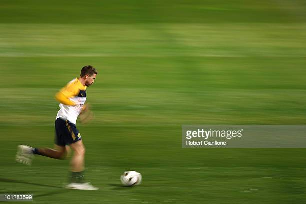 Harry Kewell of Australia runs with the ball during an Australian Socceroos training session at St Stithians College on May 30 2010 in Sandton South...