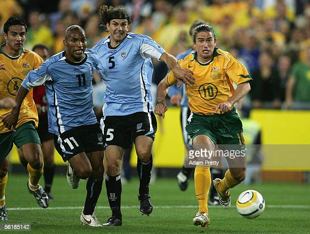 Harry Kewell of Australia sets up Marco Bresciano's goal during the second leg of the 2006 FIFA World Cup qualifying match between Australia and...