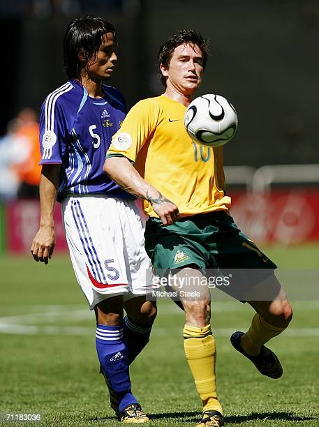 Harry Kewell of Australia shields the ball from Tsuneyasu Miyamoto of Japan during the FIFA World Cup Germany 2006 Group F match between Australia...