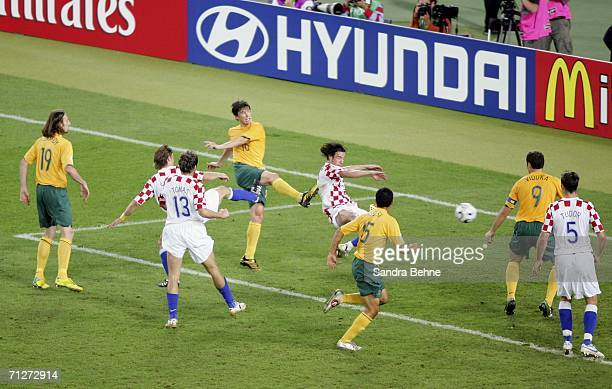Harry Kewell of Australia shoots past Darijo Srna of Croatia, to level the scores at 2-2 during the FIFA World Cup Germany 2006 Group F match between...