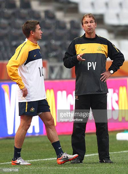 Harry Kewell of Australia talks to coach Pim Verbeek during an Australian Socceroos training session at the Mbombela Stadium on June 22 2010 in...