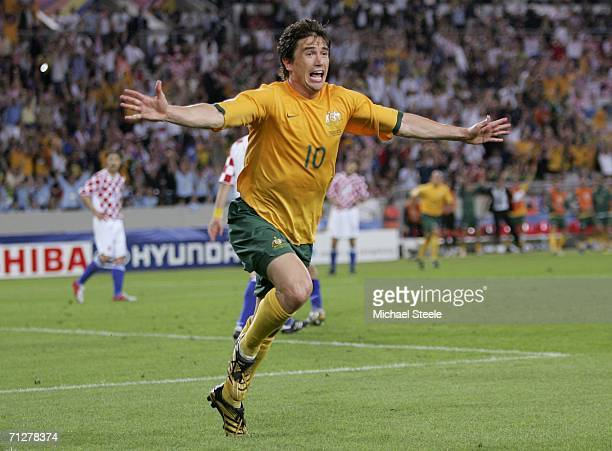 Harry Kewell of Australia turns away to celebrate after scoring his team's second goal to level the scores at 22 during the FIFA World Cup Germany...