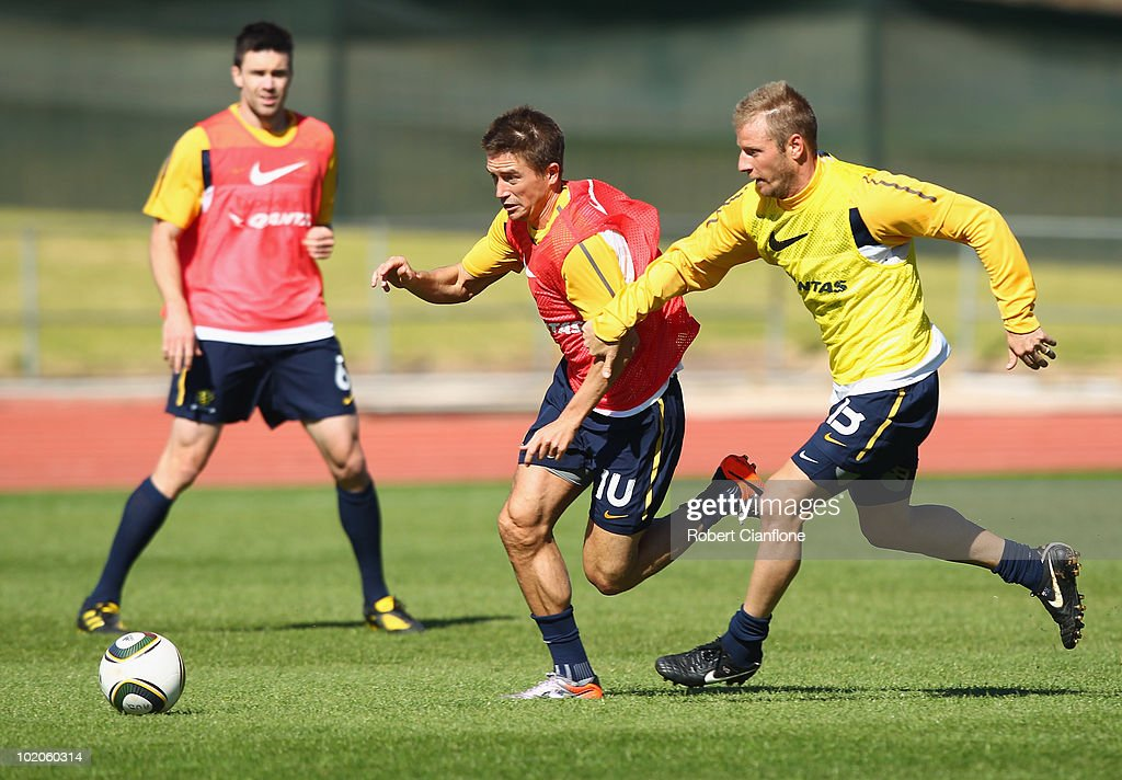 Harry Kewell of Australiais challenged by Vincenzo Grella during an Australian Socceroos training session at Ruimsig Stadium on June 14, 2010 in Roodepoort, South Africa.