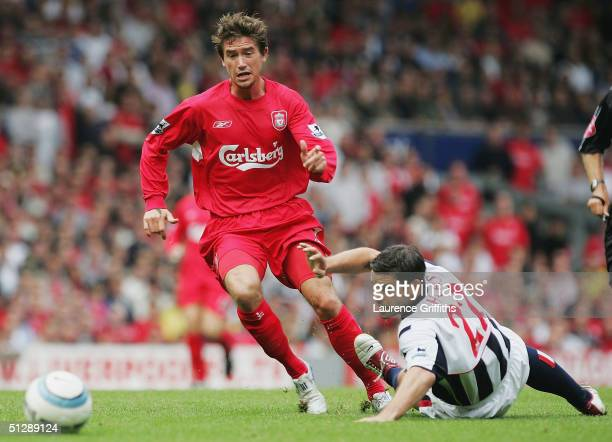 Harry Kewell of Liverpool battles with Bernt Haas of West Brom during the FA Barclays Premiership match between Liverpool and West Bromwich Albion at...