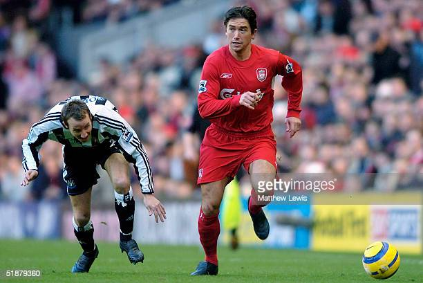 Harry Kewell of Liverpool beats Lee Bowyer of Newcastle to the ball during the FA Barclaycard Premiership match between Liverpool and Newcastle...