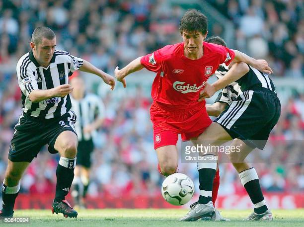 Harry Kewell of Liverpool clashes with Andrew Griffin and Darren Ambrose of Newcastle during the FA Barclaycard Premiership match between Liverpool...