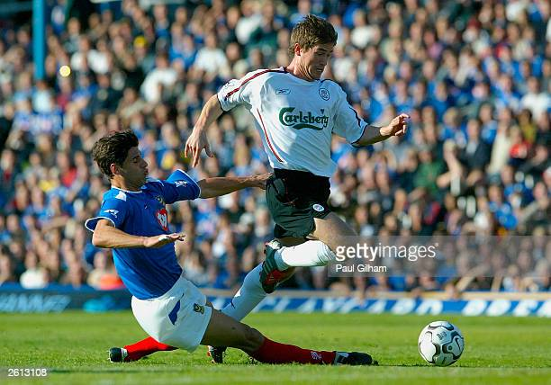 Harry Kewell of Liverpool evades a challenge from Dejan Stefanovic of Portsmouth during the FA Barclaycard Premiership match between Portsmouth and...