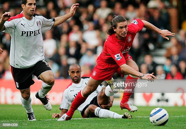 Harry Kewell of Liverpool is tackled by Alain Goma during the Barclays Premiership match between Fulham and Liverpool at Craven Cottage on October 22...
