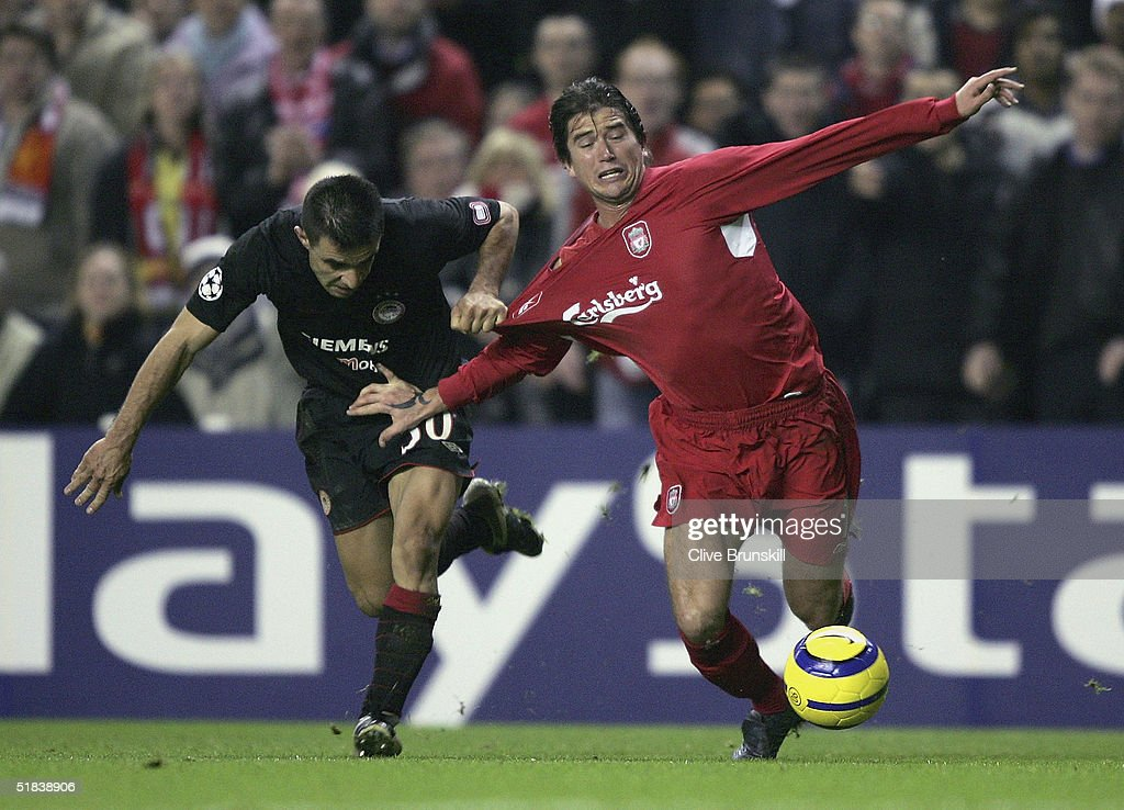Harry Kewell of Liverpool is tackled by Anastasios Pantos of Olympiakos during the Champions League Group A match between Liverpool and Olympiakos at Anfield on December 8, 2004 in Liverpool, England.