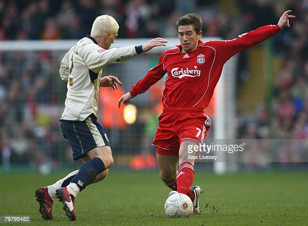 Harry Kewell of Liverpool looks for a way past Bobby Hassell of Barnsley during the FA Cup sponsored by E.on Fifth Round match between Liverpool and...