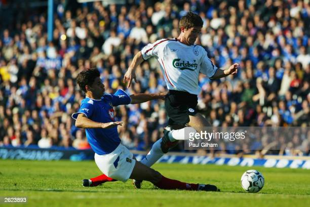 Harry Kewell of Liverpool skips past Dejan Stefanovic of Portsmouth during the FA Barclaycard Premiership match between Portsmouth and Liverpool on...