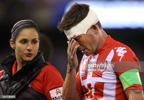 Harry Kewell of the Heart feels his nose during the round one ALeague match between the Melbourne Victory and the Melbourne Heart at Etihad Stadium...