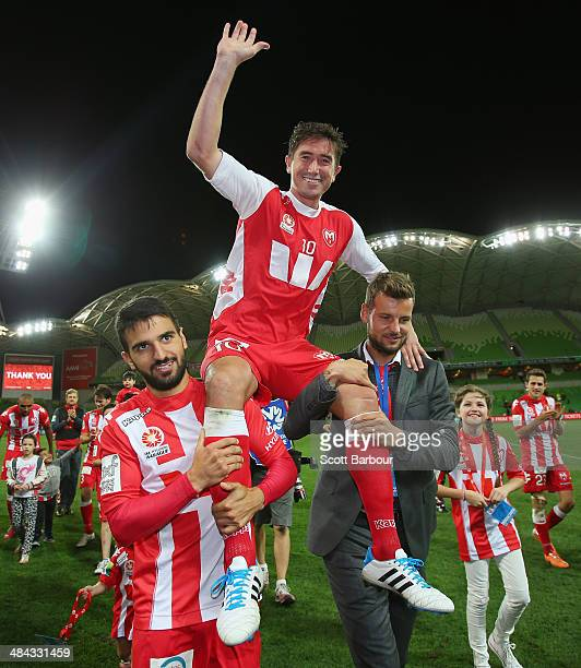 Harry Kewell of the Heart is chaired off the field after playing his final match and retiring from football during the round 27 ALeague match between...
