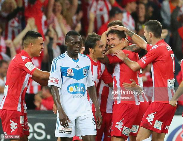 Harry Kewell of the Heart is congratulated by his teammates after scoring a goal during the round 21 ALeague match between Melbourne Heart and...
