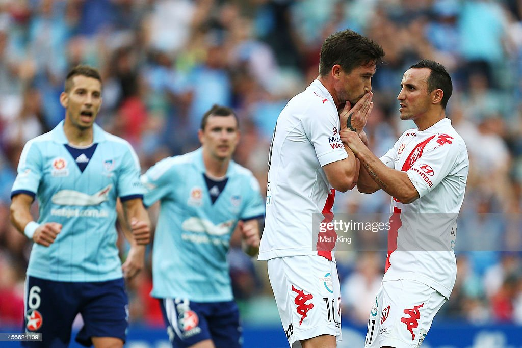 Harry Kewell (L) of the Heart reacts with Michael Mifsud (R) after missing a penalty kick during the round 10 A-League match between Sydney FC and the Melbourne Heart at Allianz Stadium on December 15, 2013 in Sydney, Australia.