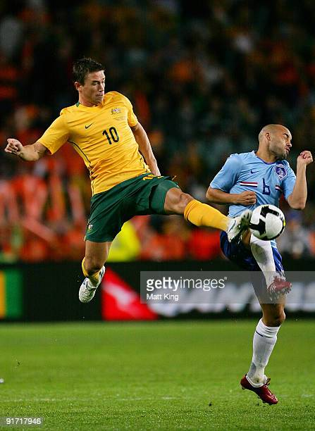 Harry Kewell of the Socceroos and Demy de Zeeuw of the Netherlands compete for the ball during the International friendly football match between...