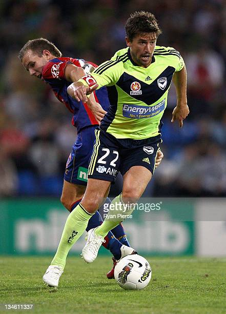 Harry Kewell of the Victory wins the ball over Jeremy Brockie of the Jets during the round nine A-League match between the Newcastle Jets and the...