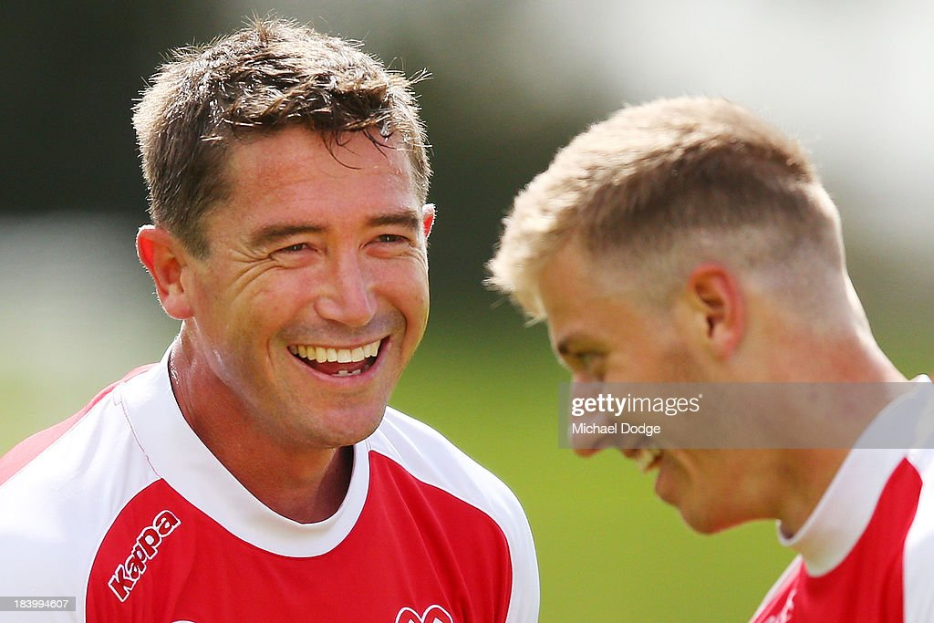 Harry Kewell (L) reacts with Stefan Mauk during a Melbourne Heart A-League training session at Epping Stadium on October 11, 2013 in Melbourne, Australia.