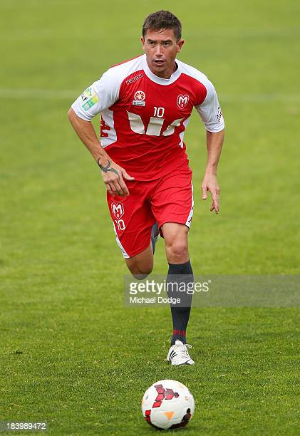 Harry Kewell runs with the ball during a Melbourne Heart ALeague training session at Epping Stadium on October 11 2013 in Melbourne Australia