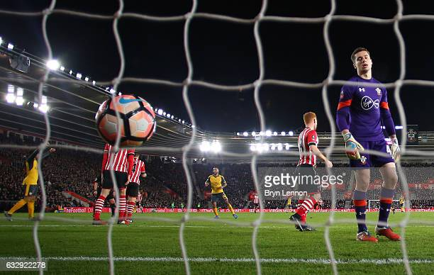 Harry Lewis of Southampton reacts after Theo Walcott of Arsenal scores his sides fourth goal during the Emirates FA Cup Fourth Round match between...