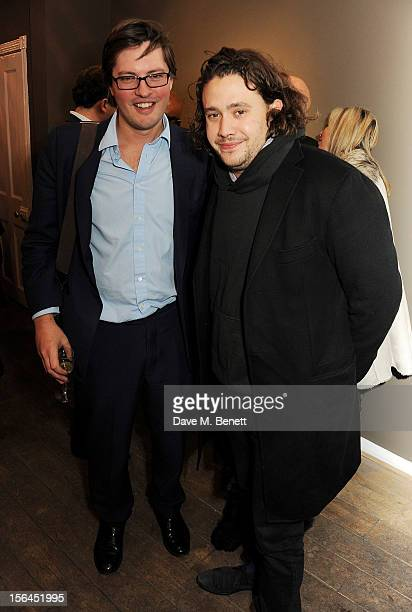 Harry Lopes and Adam Weymouth attend a private view of artist Jonathan Yeo's new exhibition 'Some People' on November 15 2012 in London England