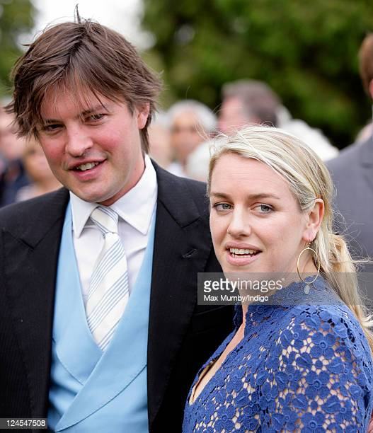 Harry Lopes and Laura Lopes attend the wedding of Ben Elliot and MaryClare Winwood at the church of St Peter and St Paul Northleach on September 10...