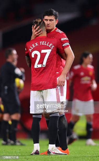 Harry Maguire and Alex Telles of Manchester United hug at the end of the Premier League match between Manchester United and West Bromwich Albion at...